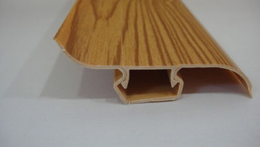 Chiny Dust Proof 80% PVC Skirting Board Covers Profile With Wood Grain Pattern fabryka
