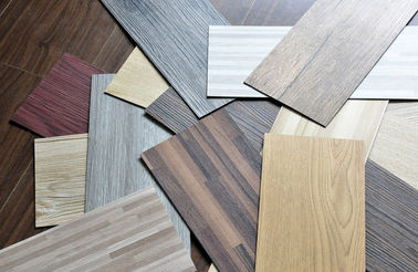 "Chiny Waterproof Wood Grain PVC Floor Tiles No - Wax 9""X48"" Installed With Glue dystrybutor"